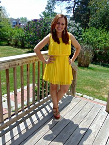 Melissa Mom with Style styling her Jessica Simpson yellow dress with brown wedges