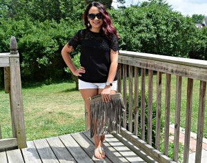 Melissa Mom with Style wearing a Thredup black lace top and white jean shorts