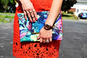 Melissa Mom with Style wearing a Forever 21 red lace skirt and a Bella V Mobile Boutique multi color clutch