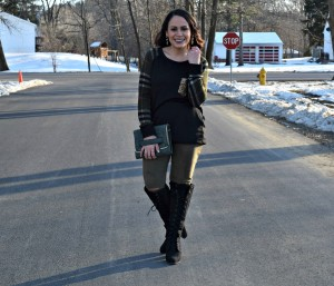 Melissa Mom with Style wearing a Bella V Mobile Boutique plaid, sequins sweatshirt over an olive green jumpsuit from Topsy Curvy Boutique with a Bella V Mobile Boutique military clutch and Target laceup tall boots