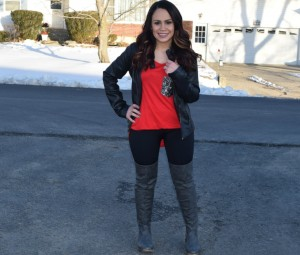 Melissa Mom with Style wearing a leather jacket from TJ Maxx, a sequins pocket long sleeve tee with a pair of black high-waisted leggings from Bella V Mobile Boutique and grey over the knee boots