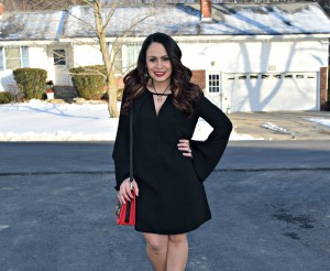 Melissa Mom with Style wearing a Bella V Mobile Boutique bell sleeve black dress with a pair of Payless animal print pumps and a red printed Charming Charlie purse