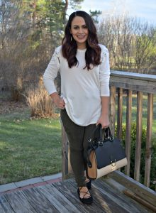 Melissa Mom with Style wearing Target olive utility pants and a Bella V Mobile Boutique white top with a Nine West handbag