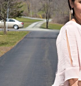 Melissa Mom with Style wear a Who What Wear spring blush ruffle top and gold and cream drop earrings