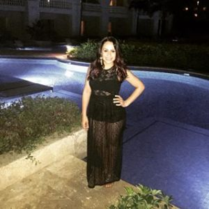 Melissa Mom with Style wearing a black Bella V Mobile Boutique maxi dress