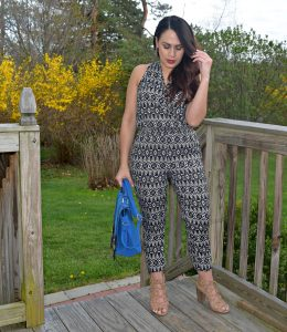 Melissa Mom with Style wearing a Loft petite jumpsuit with a pair of Target gladiator heels and a blue JustFab handbag