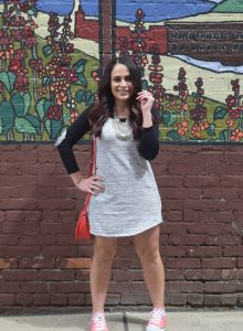 Melissa Mom with Style creating a athleisure look with a Bella V Mobile Boutique t-shirt dress, converse and a bright coral crossbody handbag