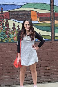 Melissa Mom with Style wearing a Bella V Mobile Boutique tee shirt dress with a pair of converse sneakers