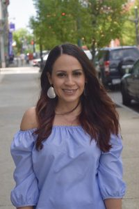 Melissa Mom with Style wearing a pair of sliver Charming Charlie statement earrings and TJ Maxx stripe off the shoulder top