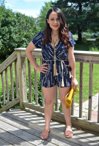 Melissa Mom with Style wearing a petite Bella V Mobile Boutique arrow print romper