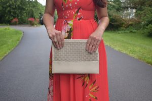 Melissa Mom with Style rose gold Charming Charlie ring along with a French Connection nude clutch