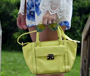 Melissa Mom with Style wearing a neon yellow Target handbag and American Eagle sunnies