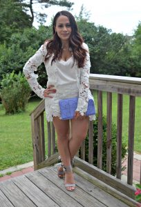 Melissa Mom with Style wearing an all white lace outfit with a lavender cltuch