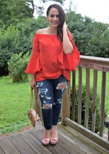 Melissa Mom with Style wearing a gorgeous tomato red off the shoulder bell sleeve top