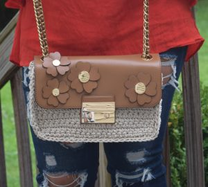 Melissa Mom with Style wearing a Michael Kors Crochet Floral crossbody bag
