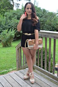 Melissa Mom with Style wearing a black off the shoulder romper with a floral Micheal Kors crossbody bag