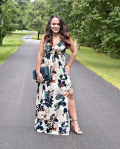 Melissa Mom with Style styling her dark floral maxi dress with rose gold jewelry