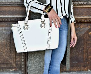 Melissa Mom with Style white stud handbag with a Aaraa Accessories fringe bracelet