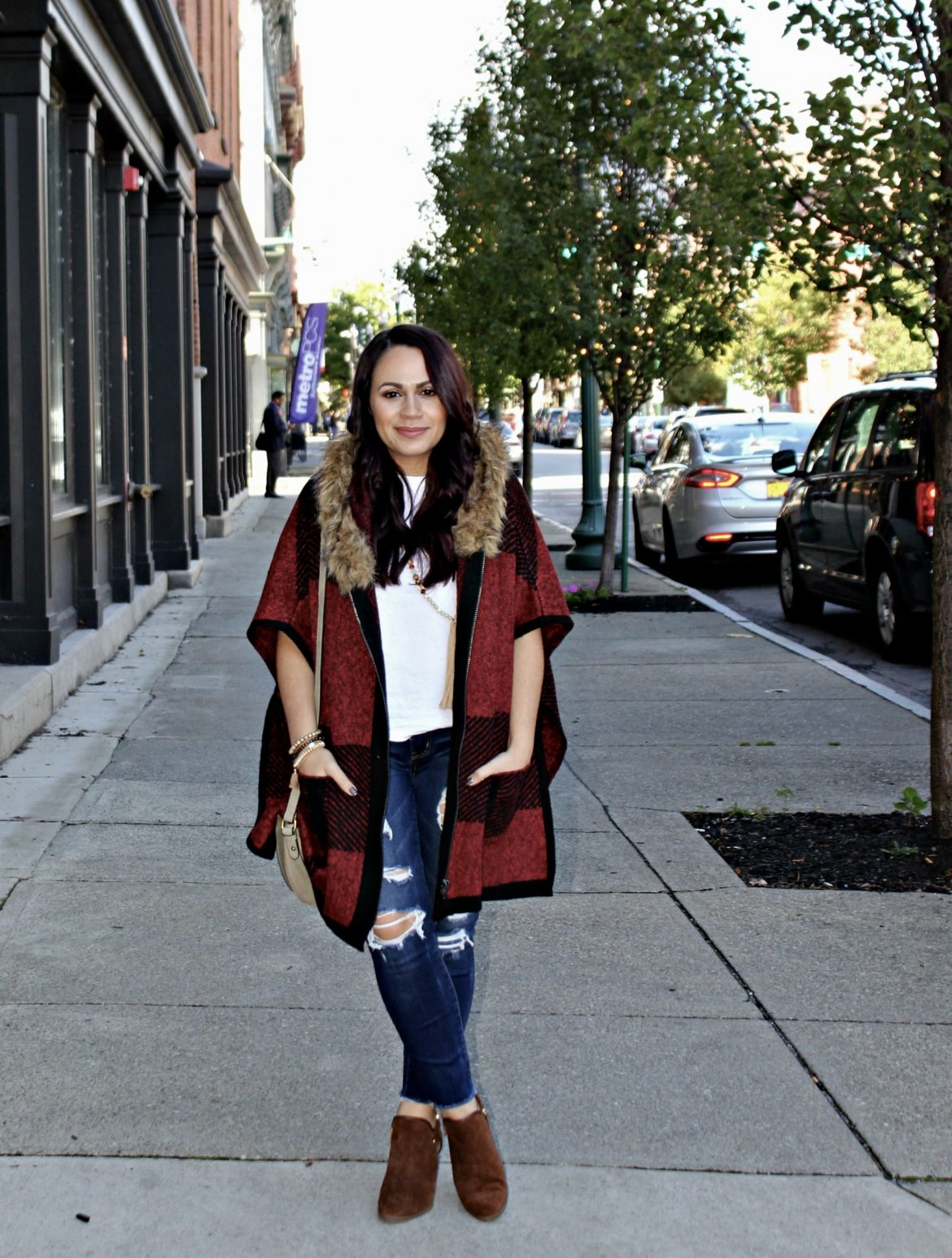 Melissa Mom with Style wearing an oversized poncho vest from Forever 21