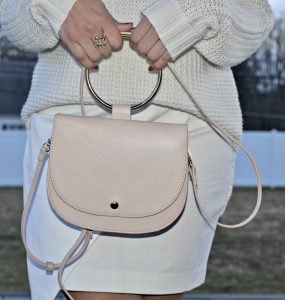 Melissa Mom with Style accessorized her all white look with a statement ring and blush bag