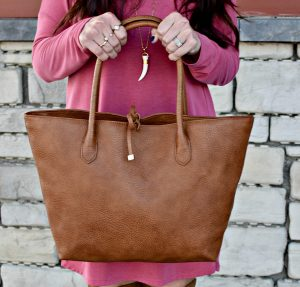 Melissa Mom with Style Open Back Tunic with gold tone jewelry and a brown Target handbag