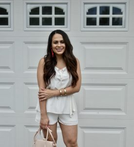 Melissa Mom with Style styling this romper with gold accessories and statement earrings